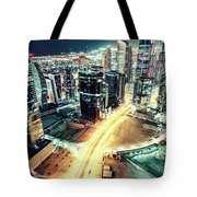 Aerial View Of Dubai's Business Bay At Night. Tote Bag
