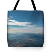 Aerial View Of Mountain Formation With Low Clouds During Daytime Tote Bag