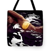 African American Woman In Bikini Lying In Black Water Tote Bag