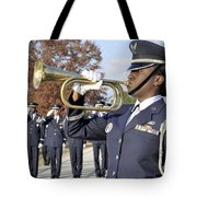 Airman Plays Taps During The Veterans Tote Bag by Stocktrek Images