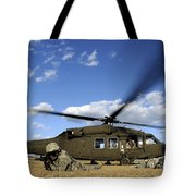 Airmen Provide Security In Front Tote Bag