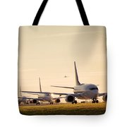 Airplanes Lining Up For Take-off Tote Bag