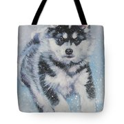 alaskan Malamute pup in snow Tote Bag