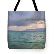Amazing View Of Azure Sky Over Rippled Surface Of Cold Sea At Sunrise Tote Bag