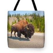 American Bison Sharing The Road In Yellowstone Tote Bag