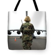 An Airfield Manager Greets An Arriving Tote Bag
