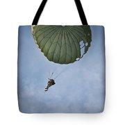 An Airman Descends Through The Sky Tote Bag