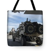 An All-terrain Vehicle Is Guided Onto Tote Bag