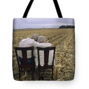 An Elderly Couple Embrace Tote Bag