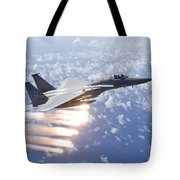 An F-15 Eagle Releases Flares Tote Bag