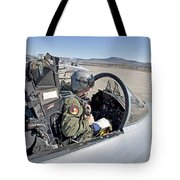 An F-15 Pilot Performs Preflight Checks Tote Bag by HIGH-G Productions