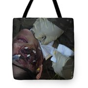 An Injured Patient Receives Medical Tote Bag