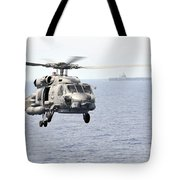 An Mh-60r Seahawk Helicopter In Flight Tote Bag