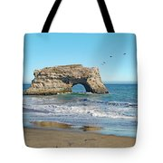 Arch In The Sea With Pelicans Flying By, At Natural Bridges State Beach, Santa Cruz, California Tote Bag