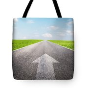 Arrow Sign Pointing Forward On Long Empty Straight Road Tote Bag