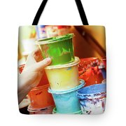 Artist Reaching For A Liquid Paint Container. Tote Bag