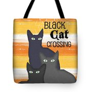 Black Cat Crossing Tote Bag by Linda Woods