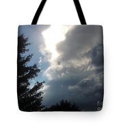 As The Clouds Move Across The Sky Tote Bag