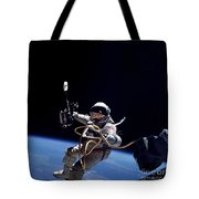Astronaut Floats In Space Tote Bag