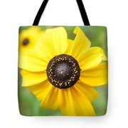 At The Center Of A Flower Tote Bag
