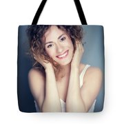 Attractive Young Woman Touching Her Hair And Face. Tote Bag