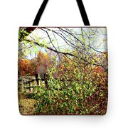 Autumn Leaves Against A Fence Tote Bag