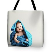 Baby Girl Covered With A Blue Warm Blanket Tote Bag