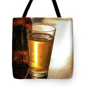 Backlit Glass Of Beer And Empty Bottle On Table Tote Bag