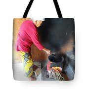 Balinese Lady Roasting Coffee Over The Fire Tote Bag