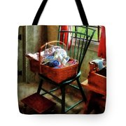 Basket Of Cloth And Yarn On Chair Tote Bag