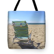Beach Chair On A Sandy Beach Tote Bag
