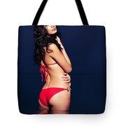 Beautiful Glamorous Woman In Red Bikini Standing In Water At Nig Tote Bag