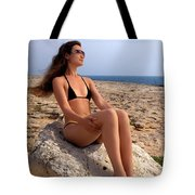 Beautiful Sexy Woman In Bikini Relaxing On A Rocky Seashore Tote Bag