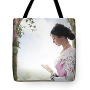 Beautiful Victorian Woman In Pink Dress Standing Under A Wisteri Tote Bag