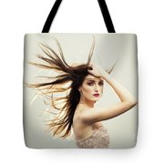 Beautiful Young Woman With Windswept Hair Tote Bag