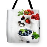 Berries In Bowls  On Wooden Background. Tote Bag
