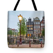 Bikes And Houses Along Canal At Dusk Tote Bag