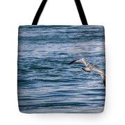 Bird In Flight Over Water Tote Bag