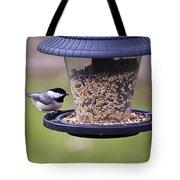 Bird On Feeder Tote Bag