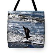 Bird Taking Flight On The Shore Tote Bag