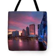 Blue Bridge Red Sky Jacksonville Skyline Tote Bag by Debra and Dave Vanderlaan