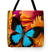 Blue Butterfly On Brightly Colored Flowers Tote Bag by Garry Gay