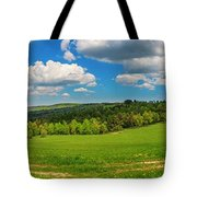 Blue Cloudy Sky Over Green Hills And Country Road Tote Bag