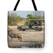 Blue Wildebeest Beside Puddle With Jeep Behind Tote Bag