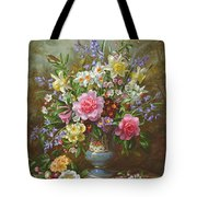 Bluebells Daffodils Primroses And Peonies In A Blue Vase Tote Bag