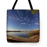 Boat Dock And Autumn Trees Along A Saskatchewan Lake Tote Bag