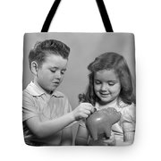 Boy And Girl Putting Money Into Piggy Tote Bag