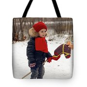 Boy On A Toy Horse Is Standing On The Street In Winter Tote Bag