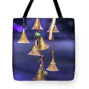 Brass Bells Hanging In The Illuminated Courtyard At Winter Night Tote Bag