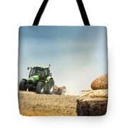 Bread And Wheat Cereal Crops.traktor On The Background Tote Bag